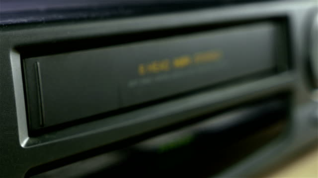 Inserting a VHS Tape into a VCR Player video