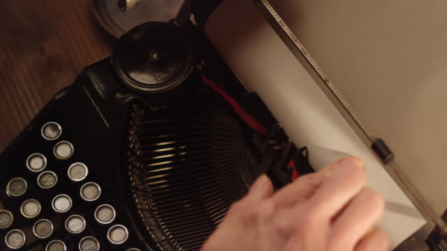 DS Inserting a white sheet of paper into typewriter video