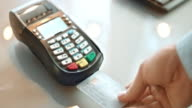 SLO MO inserting credit card and typing the code video