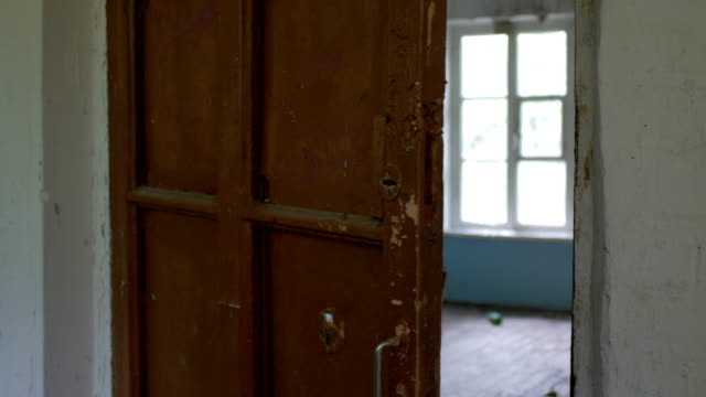 inside scary abandoned house, opening old door, empty room video