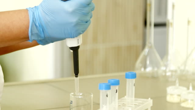 inspector takes a sample in the laboratory video