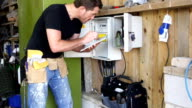 CRANE HD: Inspector with Digital Tablet at Fuse box video