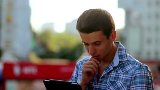 Inspirational idea came through, reading tablet pad young man video