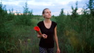 Inspired woman walking at a field video