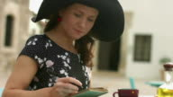 Inspired young lady writing notes in notepad, enjoying hobby in video