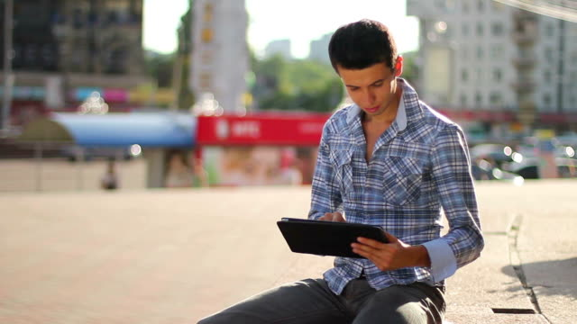 Inspiring information, male browsing tablet pc, getting news video