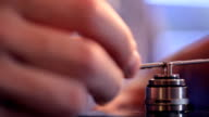 Installing a new microcoil using coil jig on clearomizer closeup video