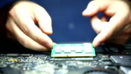 Installing RAM memory chip in laptop motherboard. video