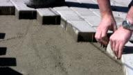 Installing Sidewalk Bricks -Close Up (HD 1080p30) video