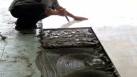 Installing tiled ceramic floor video