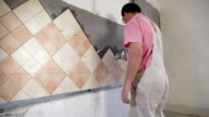 Installing Tiles - Applying mortar to wall video