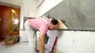 Installing Tiles - Applying mortar to wall video
