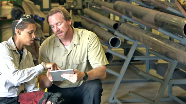 Instructor in technical school using digital tablet video
