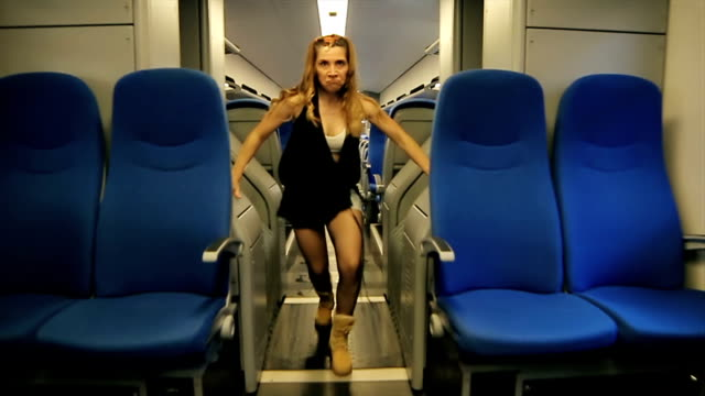 Instructor of hip hop dance dancing on the train video