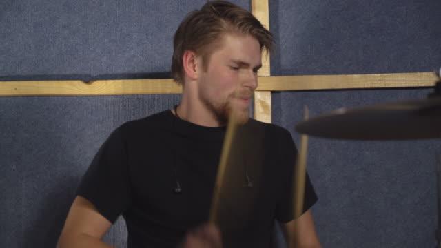 Instrumentalist rock or pop musician wearing in casual black t-shirt video