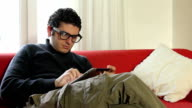 Intellectual male on tablet pc video