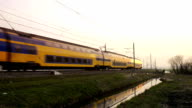 Intercity train passing in a sunset video