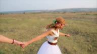 Interesting girls having good fun time outdoors running. video