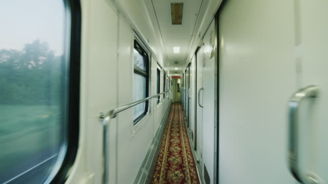 Interior of a comfortable passenger car. The camera moves along the doors of the compartment. Steadicam shot video