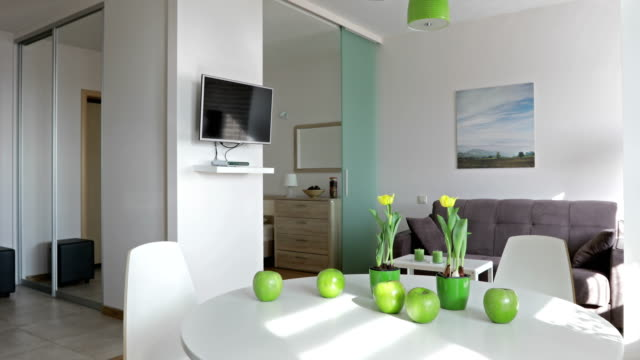 4K. Interior of a new modern apartment in scandinavian style. Motion panoramic view video