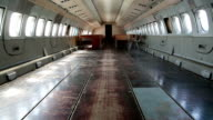 Interior of aircraft without passenger seats video
