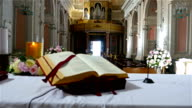 Interior of an old church in Italy preppared for a wedding ceremony video
