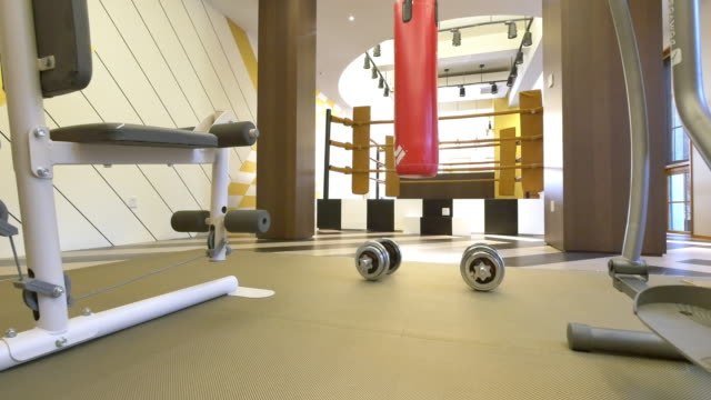 interior of gym in modern villa 4k video
