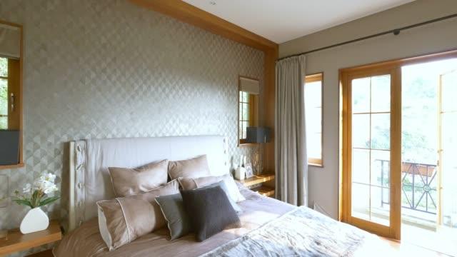 interior of modern bedroom with windows 4k video