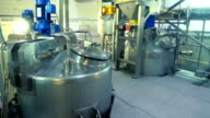 Interior of modern dairy factory. Milk tanks. Food processing equipment at factory. Food processing plant. Production of dairy products video