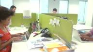 Interior Of Modern Design Office With Staff Working At Desks video