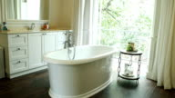 Interior view of bathroom with bathtub video
