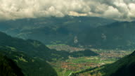 Interlaken city and valley  clouds time lapse Swiss Alps video