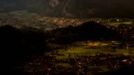 Interlaken city at sunset, sunbeams moving across valley time lapse video