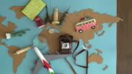 International travel plan on wooden desk video