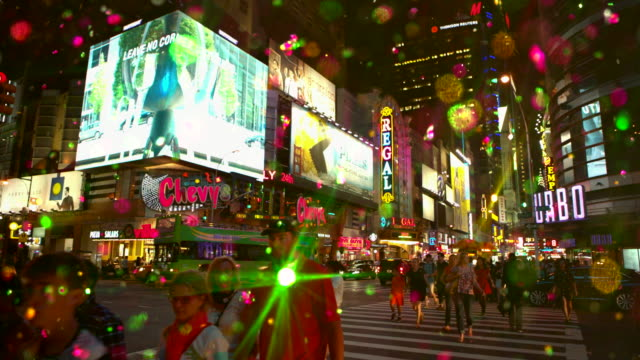Intersection in Time Square New York City with colored snow glitter video