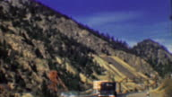 1958: Interstate highway 70 two lane road past mining tailings. video