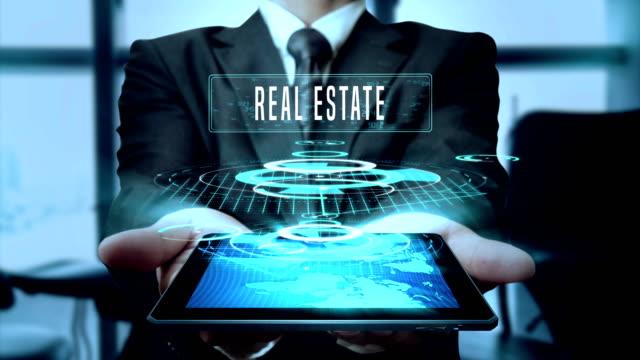 Investment Concept Businessman Using Hologram Tablet Technology - Loop video