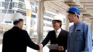 Investor shaking hands with architects for a great design video