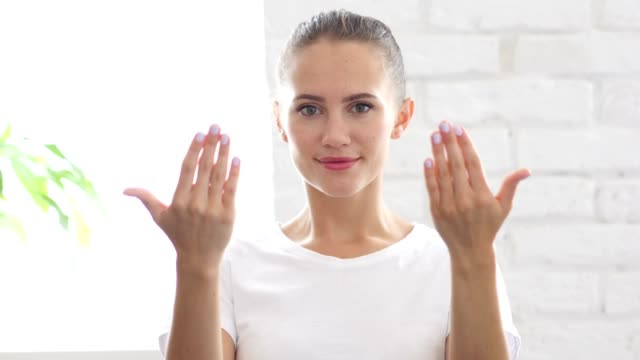 Inviting Gesture by Beautiful Young Woman, Portrait video