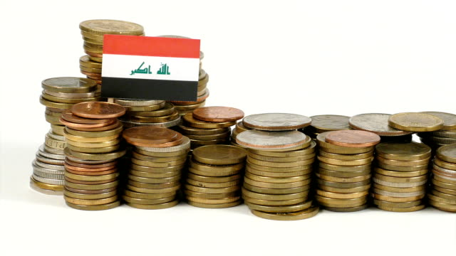 Iraq flag with stack of money coins video