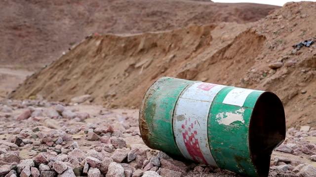 Iron barrel lies on the stony ground in Aqaba, Jordan video