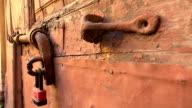 Iron bolt on a wooden door. 4K. video
