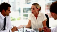Irritated businesswoman giving out to colleagues video