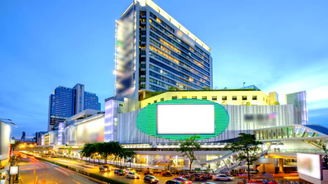 MBK is a large shopping mall in Bangkok, Thailand at dusk with traffic video
