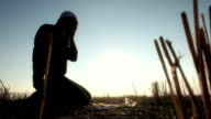 Islamic Man Prostrating In The Grass video