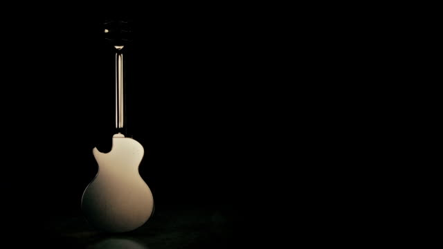 Isolated black electric guitar. 3D Rendering video
