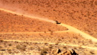 Isolated Car Drives on Desert Road in Death Valley video