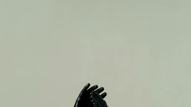 Isolated Hands on gray background completely covered with black paint video