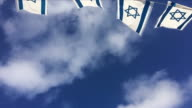 Israel flags waving in the wind video