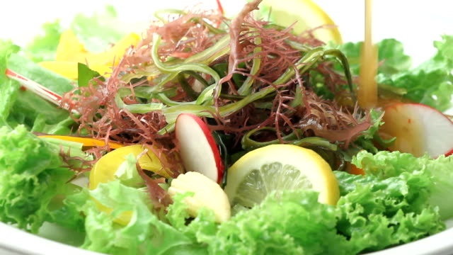 It is dressing in the seaweeds salad. video